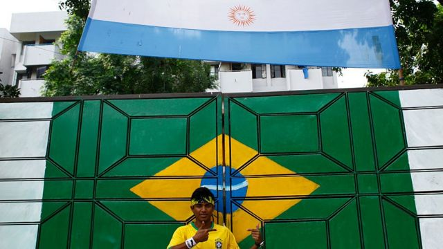 Person photographing himself with the flags of Brazil and Argentina in Bangladesh.