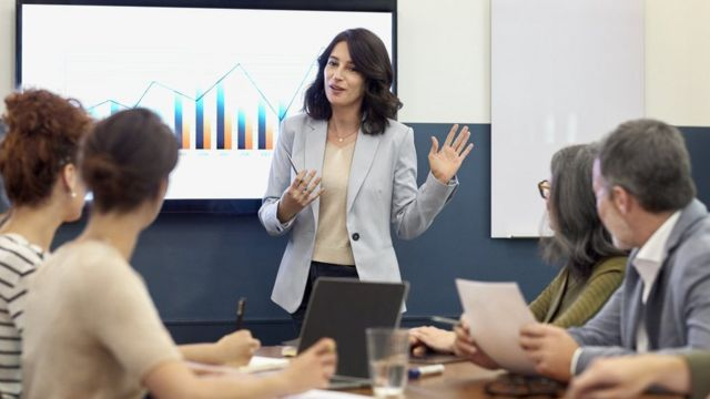 A woman makes a presentation in an office