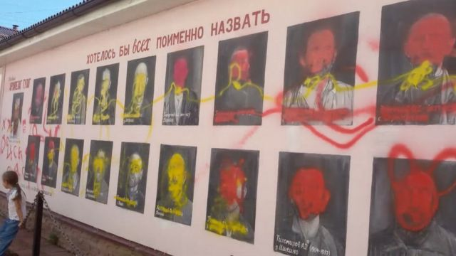 Paintings of Stalin's victims defaced