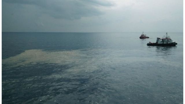 "This handout photo taken by Pertamina Hulu Energy and released on October 29, 2018 via the Twitter account of Sutopo Purwo Nugroho from Indonesia""s National Disaster Mitigation Agency shows an oil slick where Lion Air flight JT 610 reportedly crashed into the sea off the coast of Indonesia""s Java island."