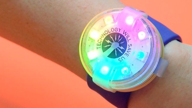 A light-up gadget strapped to a wrist