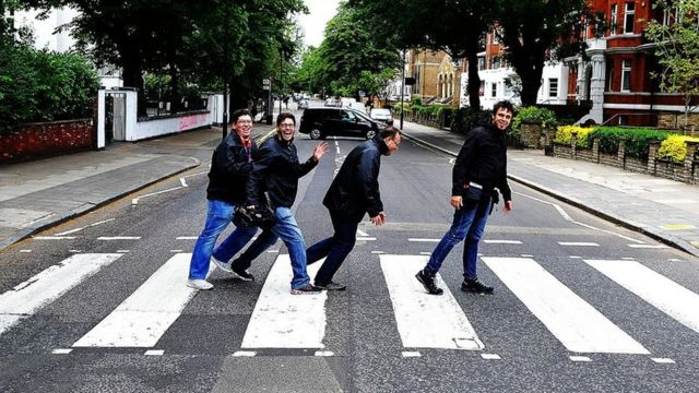 Marcelo almost falls over when trying to recreate the famous Beatles photo.