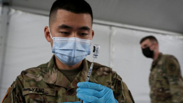 A soldier with an injection of the Pfizer vaccine