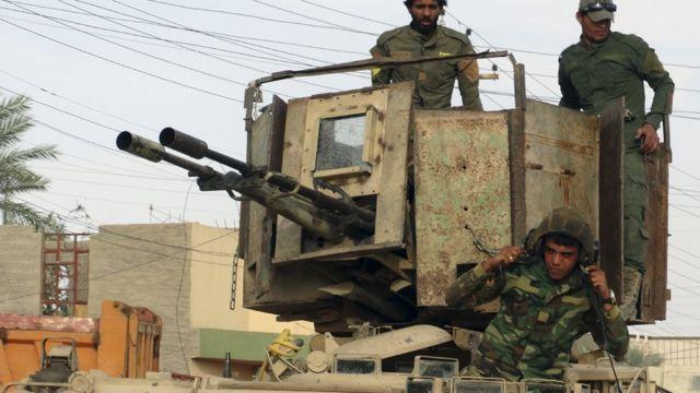 """مسلحون منتمون الى """"كتائب حزب الله"""""""