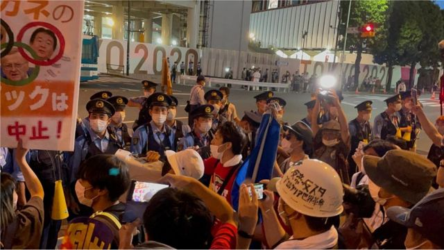 Protesters outside the New National Arena in Tokyo
