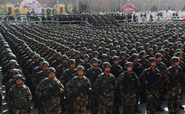 Paramilitary policemen stand in formation as they take part in an anti-terrorism oath-taking rally, in Kashgar, Xinjiang Uighur Autonomous Region, China, 27 February 2017.