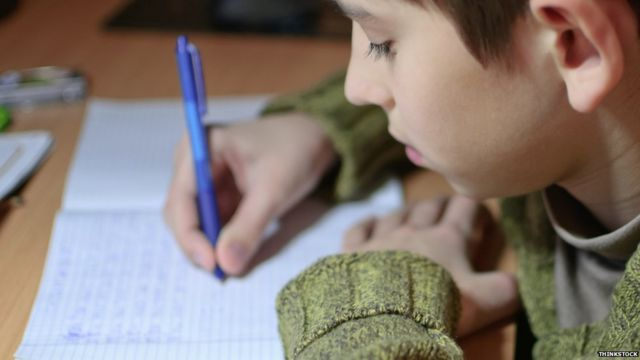 Teachers 'wasting time on marking in coloured pens'