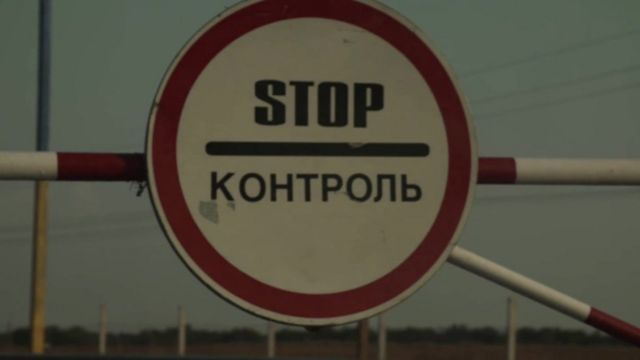 A stop sign at the border checkpoint