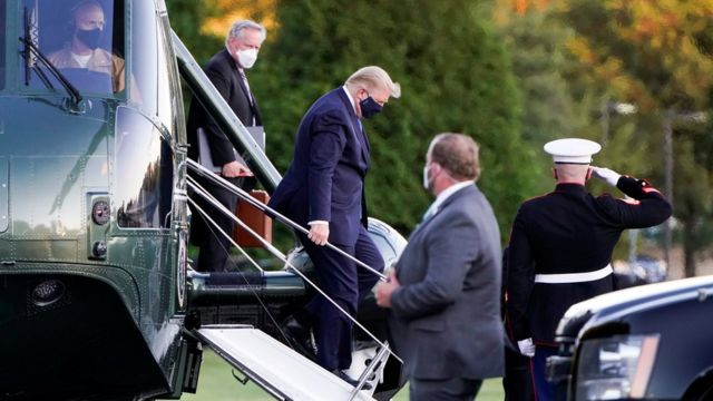 President Donald Trump disembarks from the Marine One helicopter as he arrives at Walter Reed National Military Medical Center