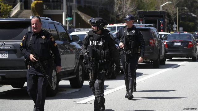 Police walk outside of the YouTube headquarters on April 3, 2018 in San Bruno, California.