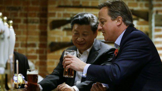 David Cameron and Xi Jinping sharing a pint at a Buckinghamshire pub