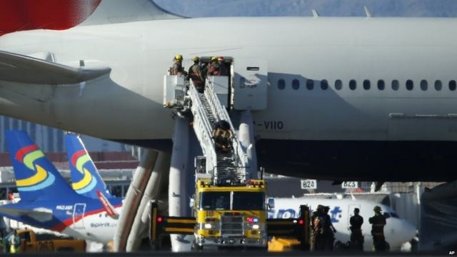 Firefighters enter the BA plane at Las Vegas airport. Photo: 8 September 2015