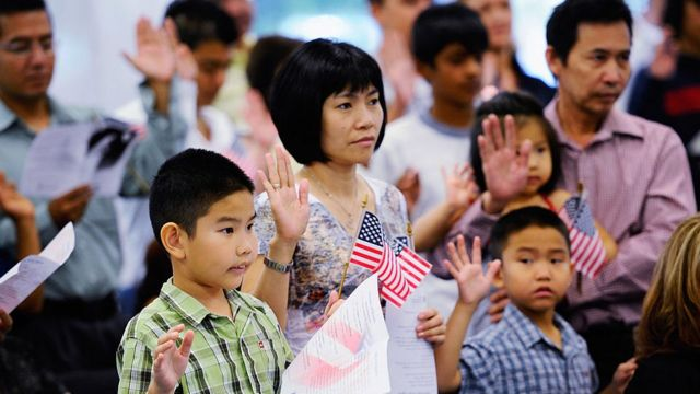 Children And Adults Are Sworn In As US Citizens During Ceremony