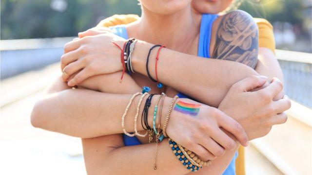 Two women embrace