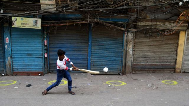 A boy playing cricket in the closed market at Sadar Bazar wholesale market during the weekend lockdown imposed by the State government to curb again spike of coronavirus (Covid-19) cases
