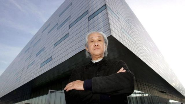 Japanese architect Arata Isozaki poses in front of the Palahockey designed with Italian architect Pier Paolo Maggiora in Turin, Italy, on 20 December 2005