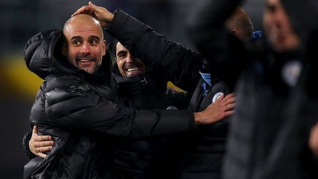 Guardiola celebrates with his coaching staff at Man City