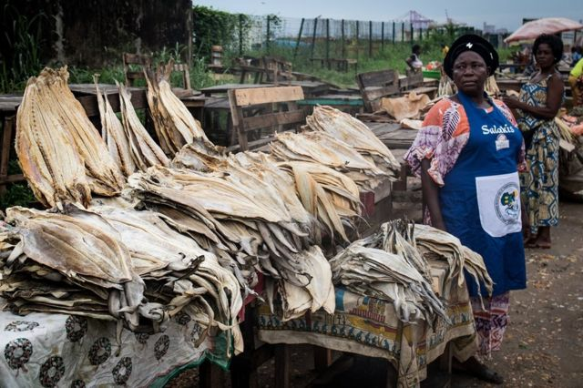 A merchant sells dried fish