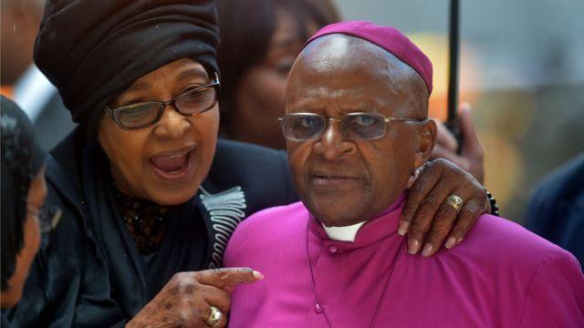 elson Mandela's former wife Winnie MadikizelaMandela speaks with South African Archbishop and Honorary Elders Desmond Tutu during the memorial service of South African former president Nelson Mandela at the FNB Stadium (Soccer City) in Johannesburg on December 10, 2013