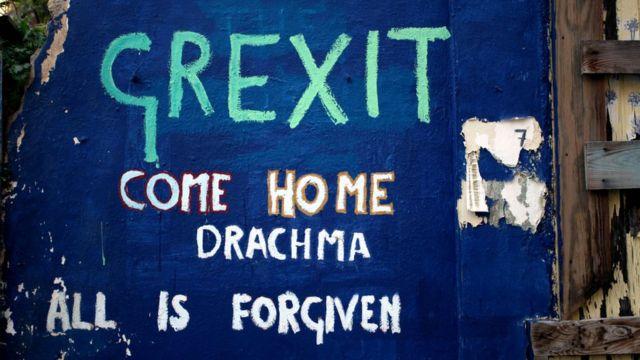Atina sokaklarında 'Grexit' yazısı.