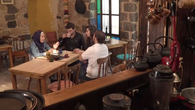 Syrians discuss the US presidential election at a cafe in Damascus.