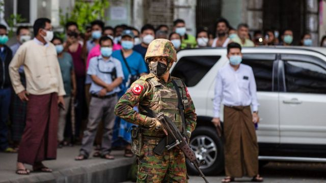 A soldier stands guard in Yangon