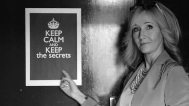 JK Rowling with sign