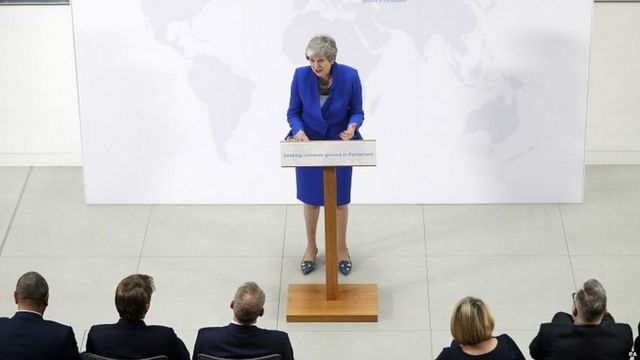 Theresa May speaking in London