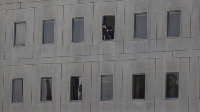 An Iranian policeman looks out of the parliament building in central Tehran, Iran, June 7, 2017