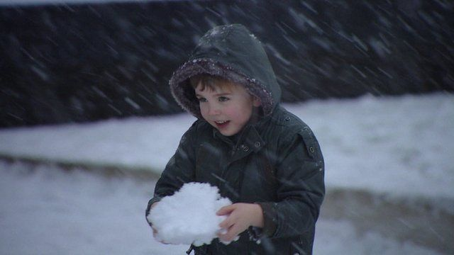 Boy with snowball in Scotland