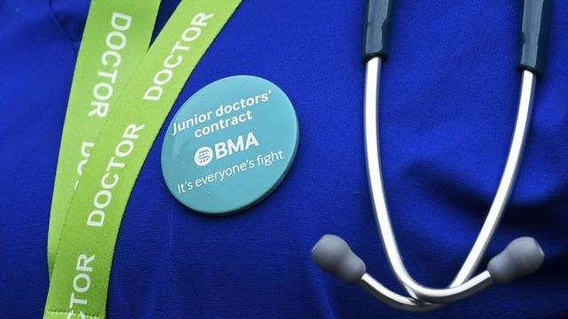 Junior doctor wearing protest badge
