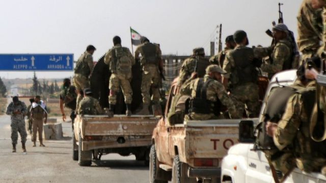 Turkish-backed Syrian fighters are pictured in the town of Ayn al-Arus