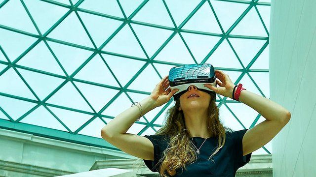 Woman in British Museum wearing VR headset