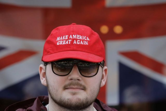 A pro Donald Trump supporter is seen outside Windsor Castle in Windsor