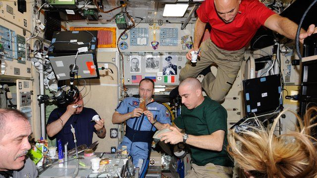 Astronauts sharing a meal