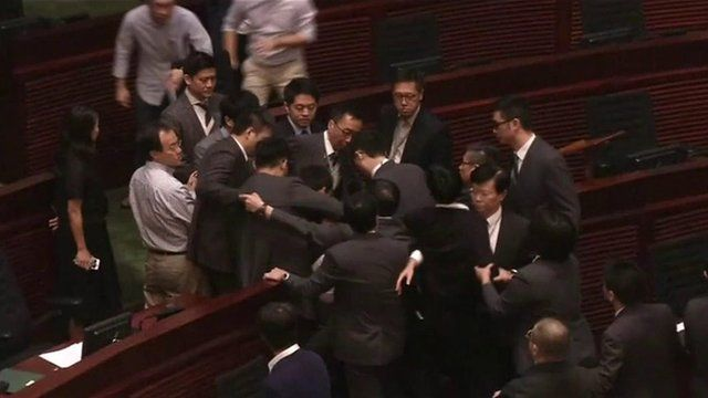 Scuffles have broken out at Hong Kong's legislative assembly again. Two newly-elected pro-independence MPs have tried to force their way in to be sworn in.