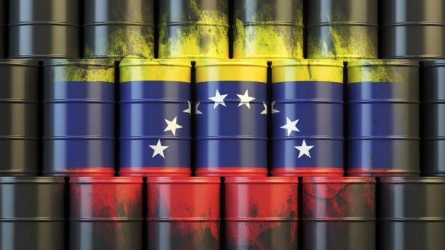 Venezuela flag and oil barrels.