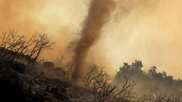 A whirlwind of hot ash and embers moving through wildfires burning in the Santa Barbara Hills, California.