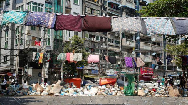Sarongs hang on washing line in Myanmar