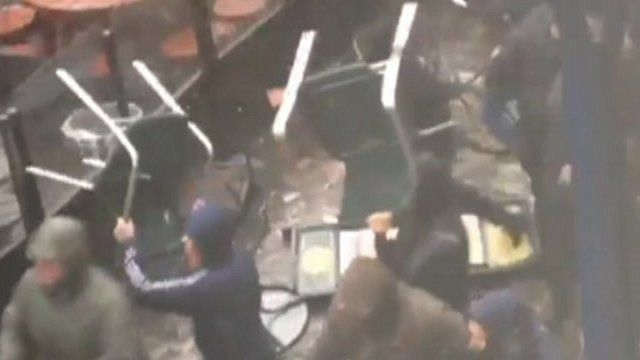 Football fans throw chairs in Manchester fight - BBC News