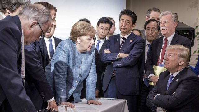 Trump surrounded by other world leaders at the G8 summit in Canada in 2018