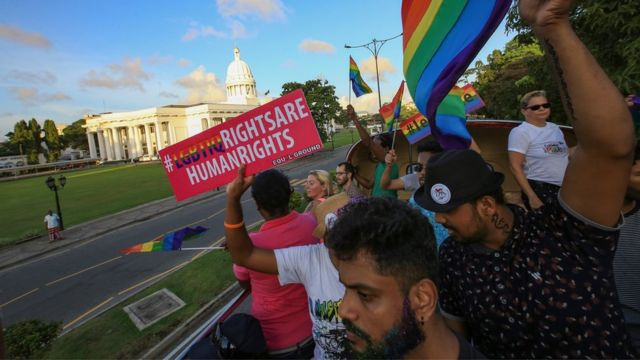 """A Sri Lankan man holds a placard which states """" LGBTIQ rights are human rights' at Colombo, Sri Lanka on Saturday 17 June 2017"""