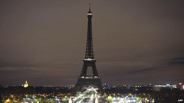 The Eiffel Tower with its lights turned off following the deadly attacks in Paris