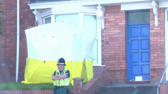 Police outside Alec Warburton's home
