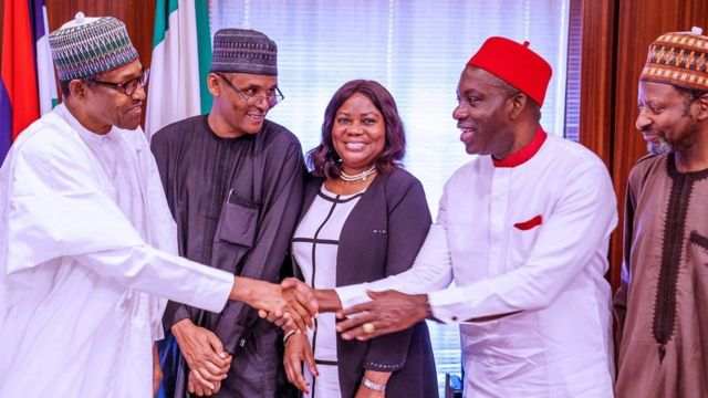 Buhari dey shake Soludo wey im appoint for Members of Presidential Economic Advisory Council (PEAC) for September 2019.