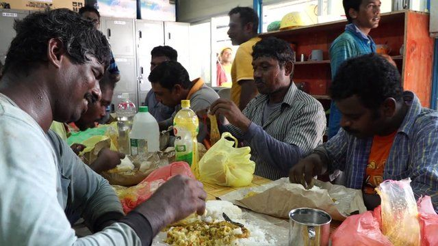 Workers eating rice