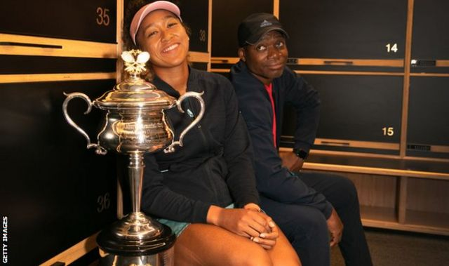 Naomi Osaka pictured with her dad and the Australian Open trophy