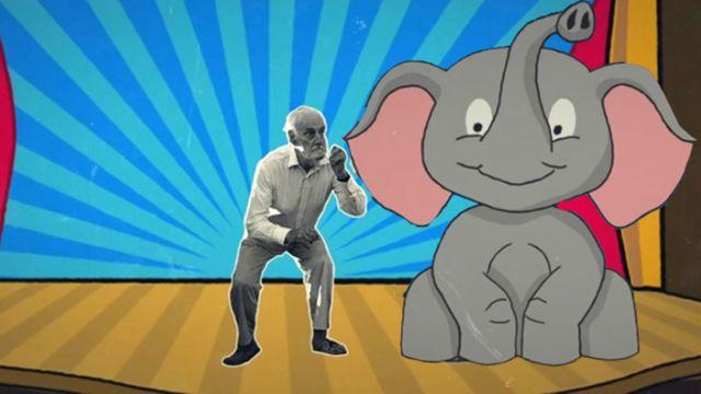 Norman Frederick Simpson y un elefante
