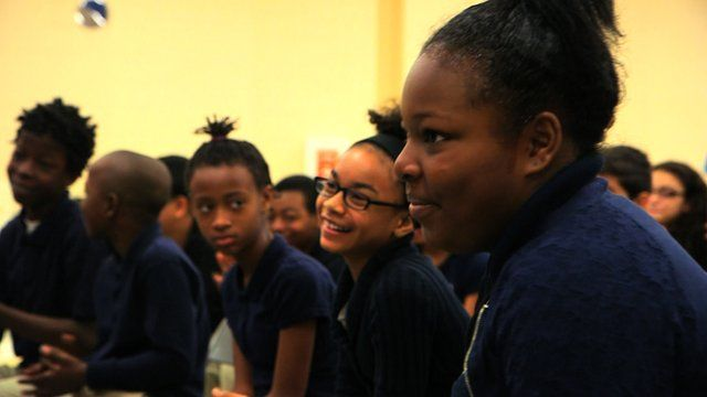 Students in the Embassy Adoption Program enjoy a musical performance