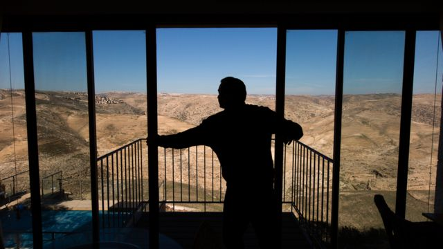 The man opens the window of the house in the Jewish apartment